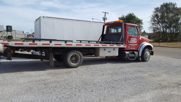Eldon's Automotive Repair flatbed tow-truck